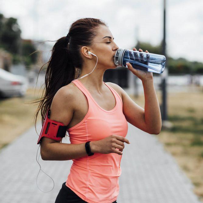 medium-shot-woman-drinking-water